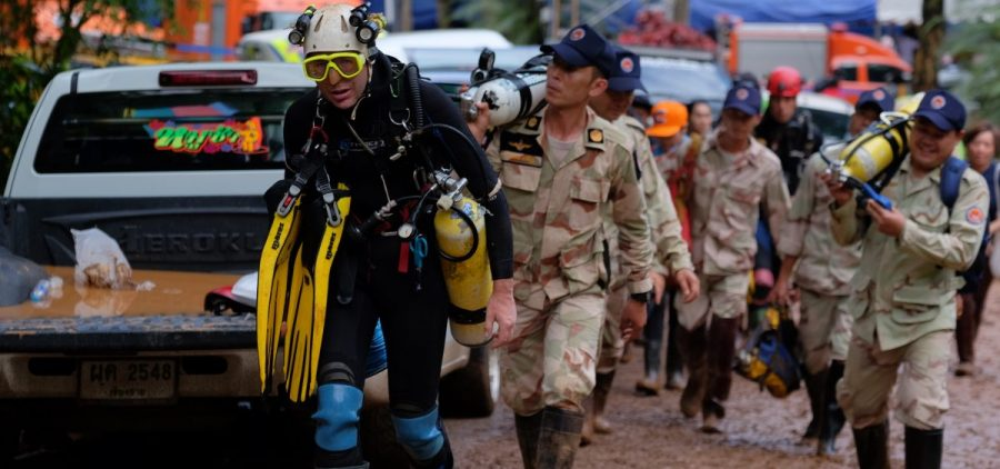 British cave-diver John Volanthen walks out of the flooded Tham Luang cave on Thursday. Rescue teams in Thailand have been working around the clock to save 12 boys and their soccer coach who went missing Saturday evening.