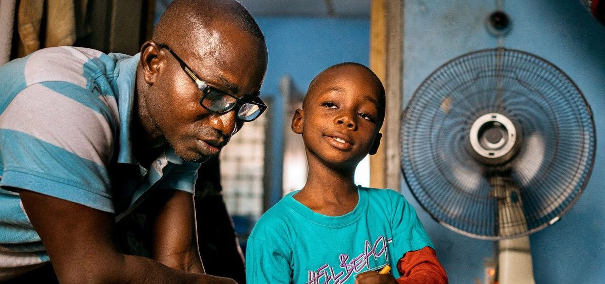 It's their nightly ritual: Herman Agbavor sits down with his 5-year-old son, Herbert, to go over his homework.