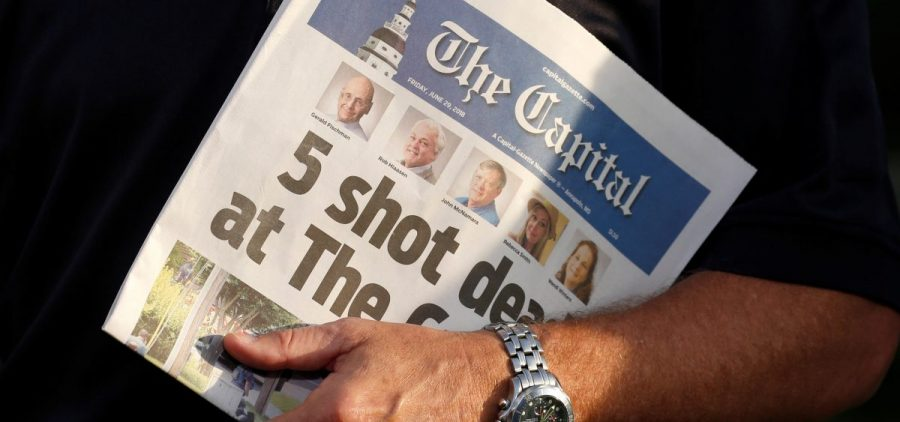 Steve Schuh, county executive of Anne Arundel County, Md., holds a copy of Friday's The Capital.