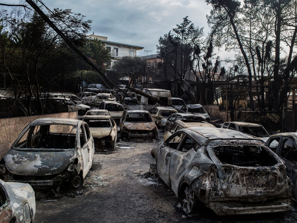 Cars burnt following a wildfire at the village of Mati, near Athens, on July 24, 2018.