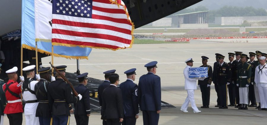 A U.N. honor guard at Osan Air Base in Pyeongtaek, South Korea, carries a box containing remains believed to be from American servicemen killed during the Korean War after they arrived from North Korea on Friday.