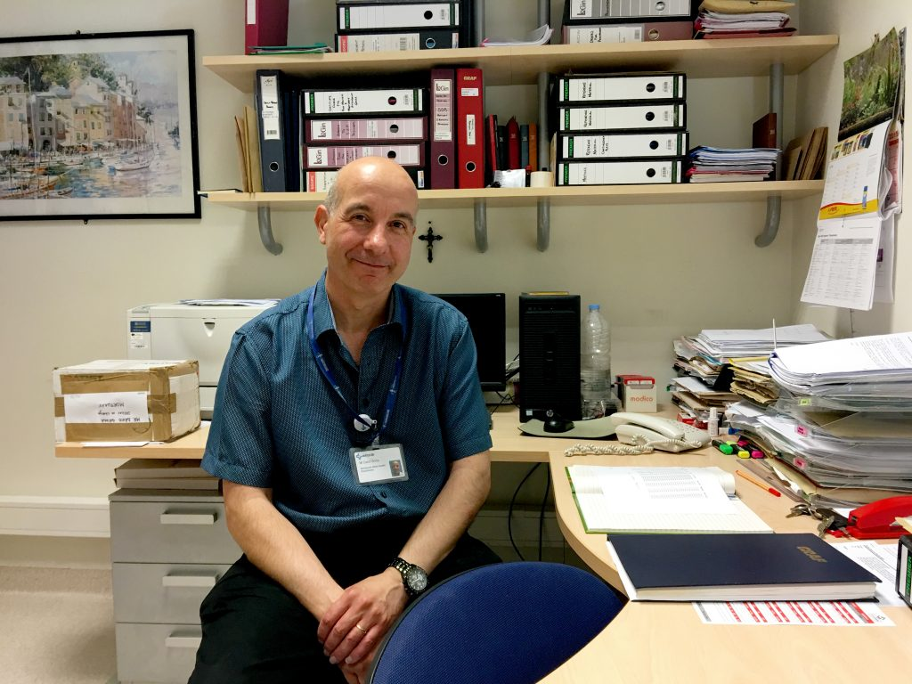 Dr. David Grima at his office in the morgue of Mater Dei, Malta's main hospital. Grima, the morgue's manager, supervised the autopsies of 24 unidentified migrants who drowned at sea.