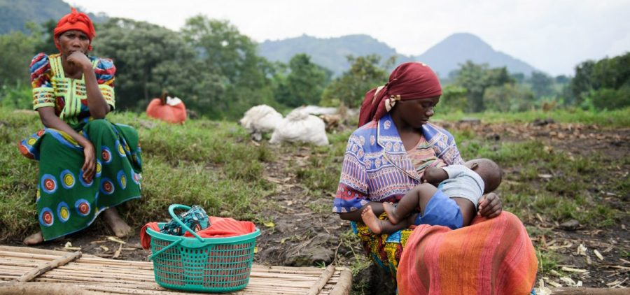 A woman breastfeeds her child in a village in the Democratic Republic of the Congo.