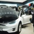 Customers look at Tesla cars at a showroom in Hangzhou in China's eastern Zhejiang province on April 4. The cut in Chinese auto import tariffs could help Tesla, which has been looking to break into the Chinese market.