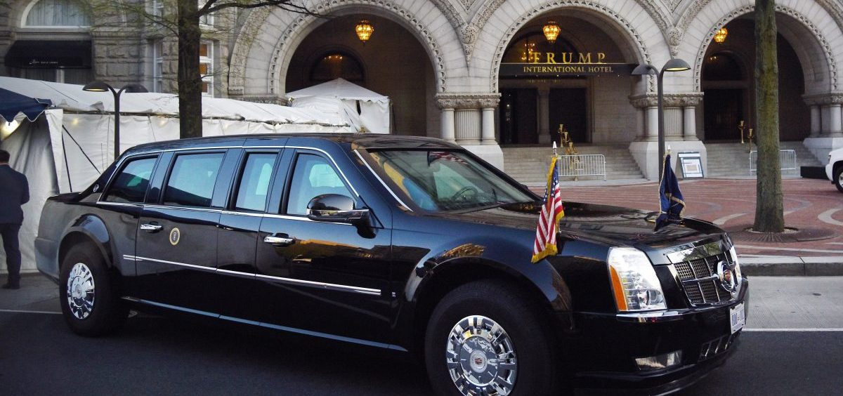 The presidential limousine is parked in front of the Trump hotel as President Trump attends a dinner with supporters in April 2018 in Washington, DC. The hotel is a focal point of litigation that charges Trump's continued business interests violate the Constitution.