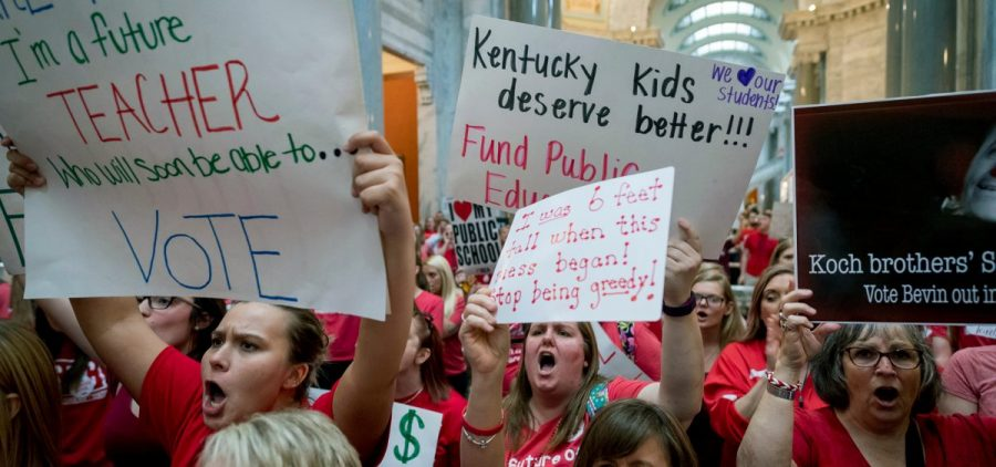 Teachers from across Kentucky gather inside the state Capitol to rally for increased funding for education, Friday, April 13, 2018, in Frankfort, Ky.