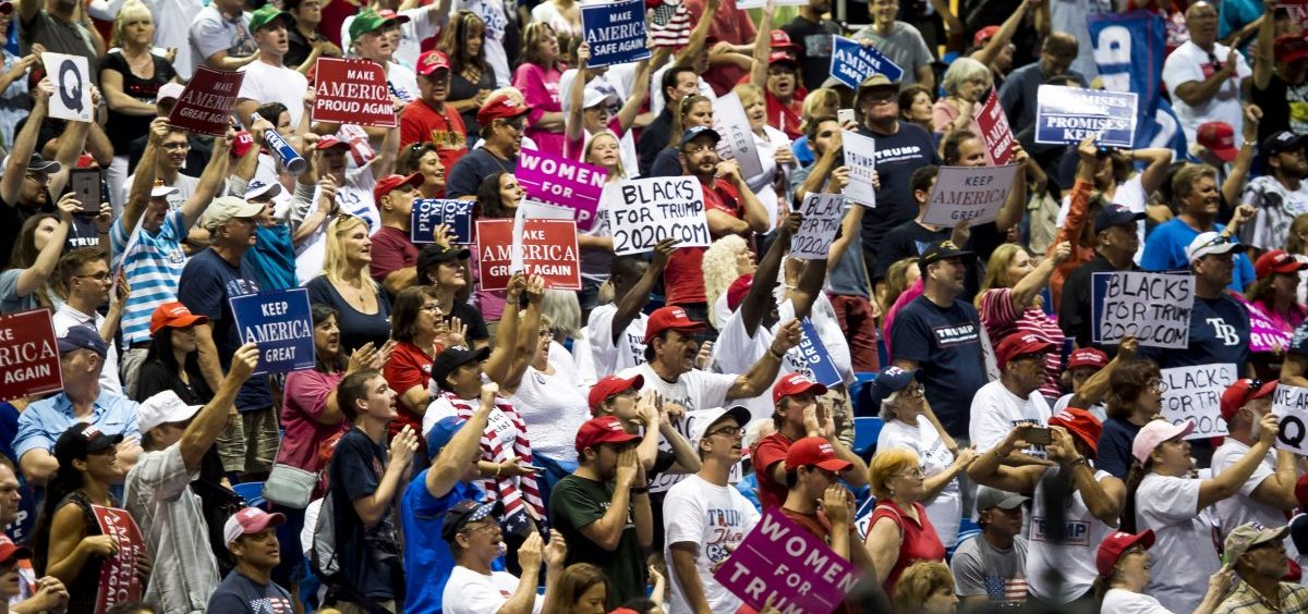 """Signs bearing the letter """"Q"""" are visible at President Trump's campaign rally in Florida on Tuesday. They're related to the """"QAnon"""" conspiracy theory."""