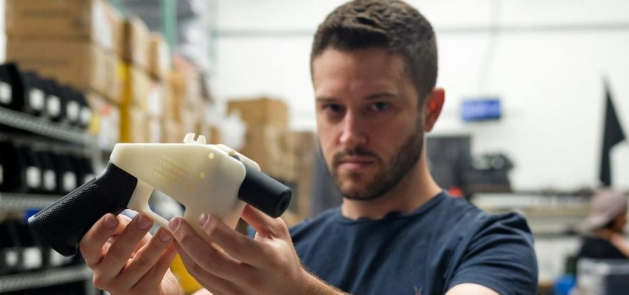 "Cody Wilson, owner of Defense Distributed, holds a 3D printed gun called the ""Liberator"" in his factory in Austin, Texas, on Aug. 1."
