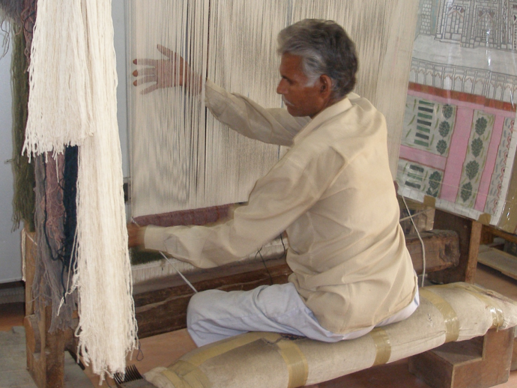 No special chair required: A man in Rajasthan, India, sits at his loom, weaving for hours each day with exemplary posture. He untucks his pelvis and elongates his spine.