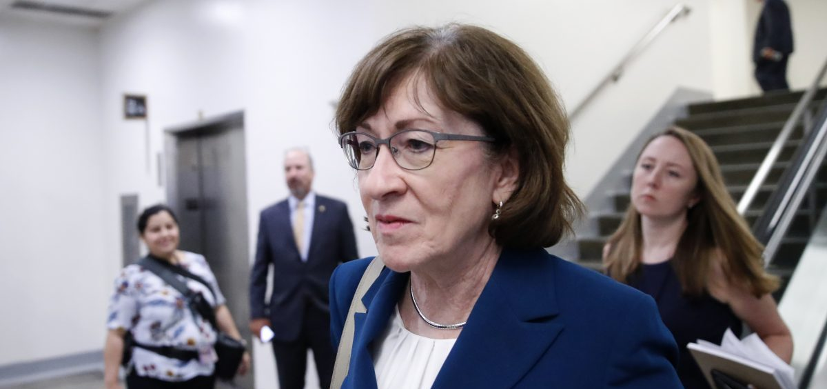 """Sen. Susan Collins, R-Maine, walks on Capitol Hill on Wednesday. A key vote on Brett Kavanaugh's Supreme Court nomination, she said Thursday that the FBI investigation seemed """"very thorough."""""""