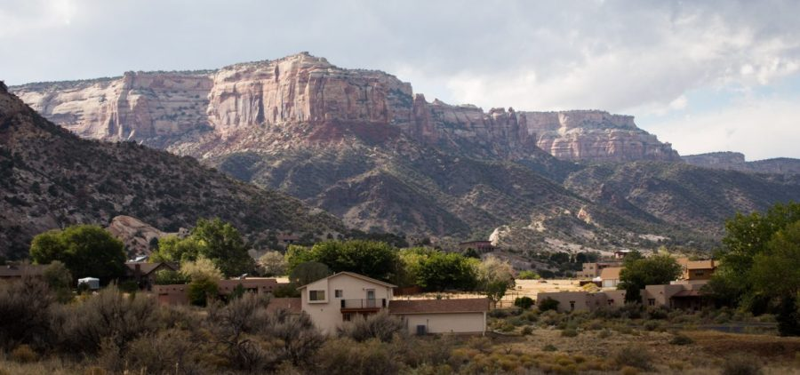 Houses lie at the base of Colorado National Monument. The school district in Grand Junction knows it could take years to see whether their efforts towards suicide prevention have worked.