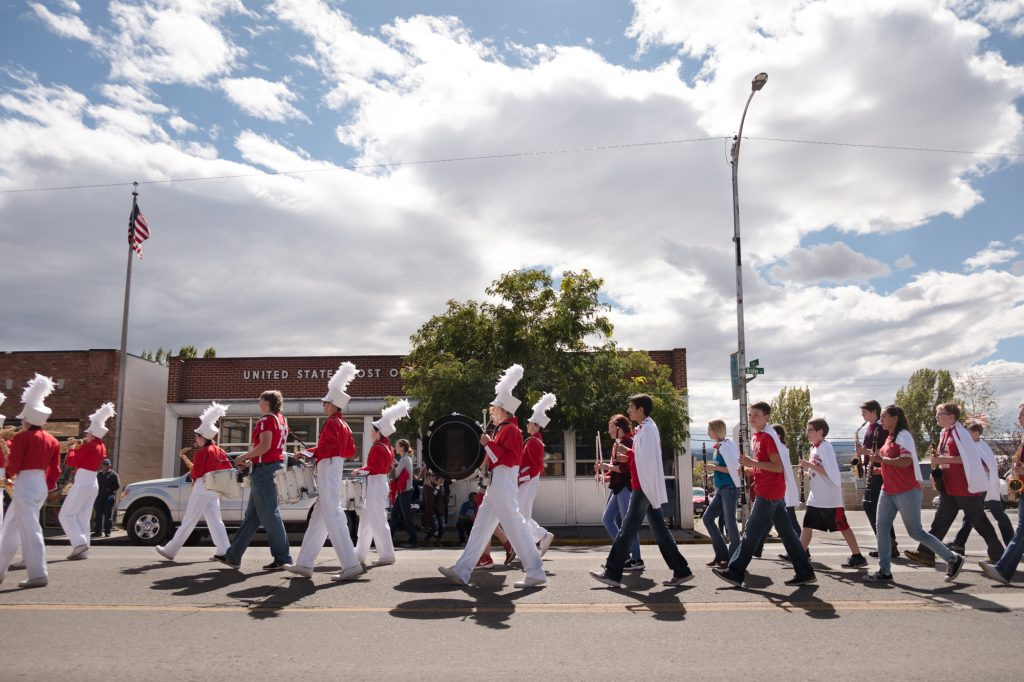The high school homecoming parade marches down the street in Hotchkiss, Colo. Locals proudly said the crowd was bigger than in recent years, a sign that people are moving to the town.