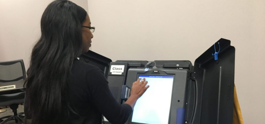 Sharyn Rigsbee demonstrates special voting machine.