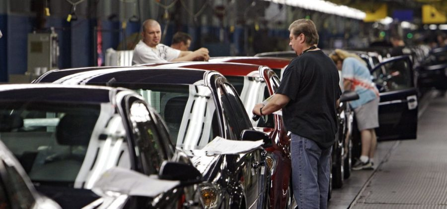 Workers at General Motors' Lordstown Assembly plant in Lordstown, Ohio put the final touches on Chevy Cobalts.