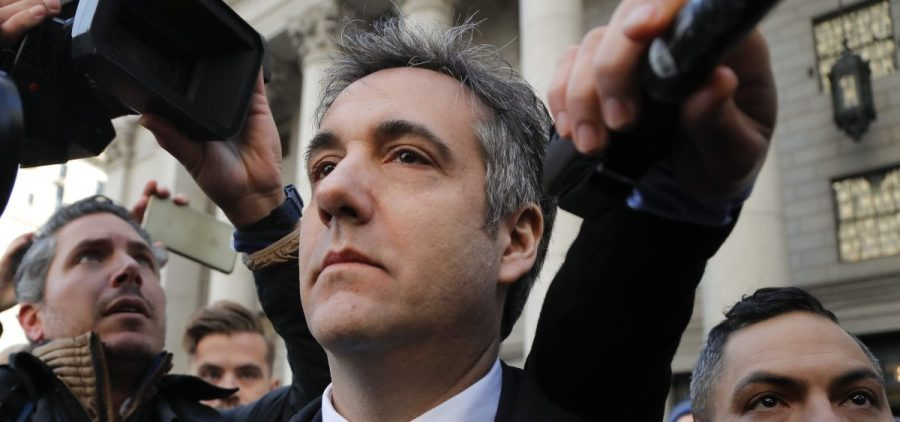 Michael Cohen walks out of federal court on Thursday in New York. Cohen admitted he lied to Congress about Donald Trump's real estate negotiations in Moscow.