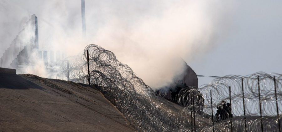 Tear gas thrown by U.S. border agents is seen near the border crossing in Tijuana, Mexico, on Sunday.