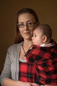 Philman holds her six-month old son, who was born healthy.