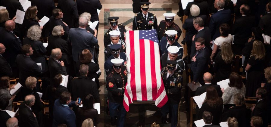 A joint service honor guard carries the casket of former President George H.W. Bush at the end of his State Funeral.