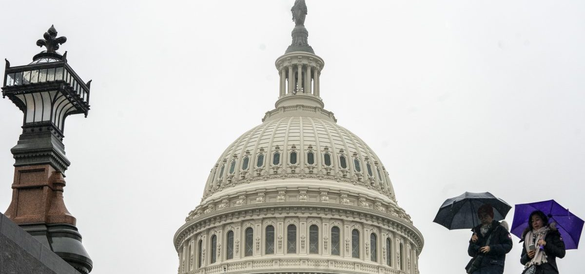 Tourists arrive to visit the U.S. Capitol on a rainy morning in Washington, Friday, Dec. 28, 2018.