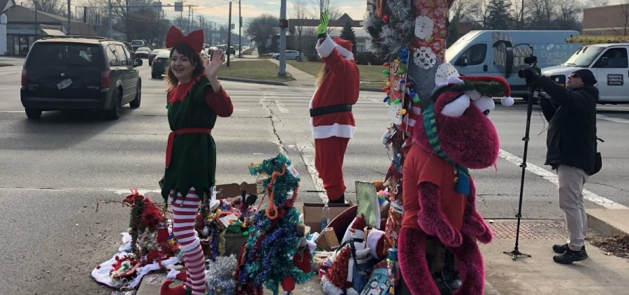 Toledo's Christmas Weed (upper left corner), which is now so heavily decorated that you can barely see it, provided a little holiday cheer at a busy intersection Wednesday.