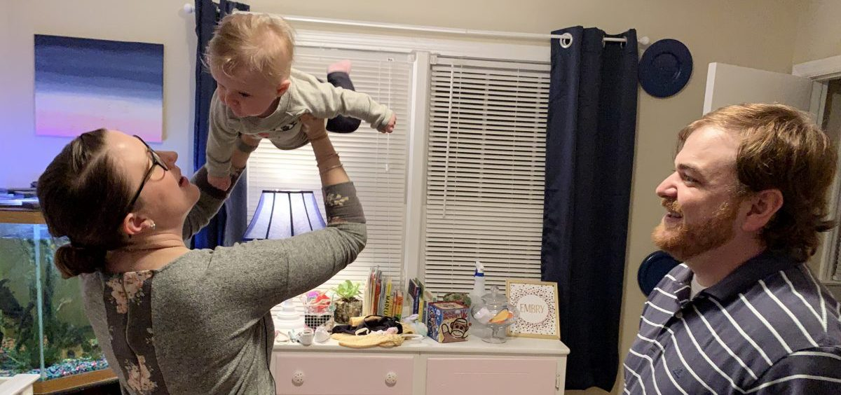 Jenna Neikirk and her husband, Zach, play with their 5-month-old, Embry, in their apartment in Atlanta.