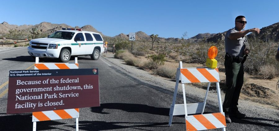 A U.S. park ranger gives a tourist suggestions of other nearby places he can visit while Joshua Tree National Park was shut down in 2013.