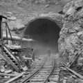 Dust circles a worker during the construction of the Hawks Nest Tunnel in 1930. Workers on the project were exposed to toxic levels of silica dust; hundreds ultimately died.