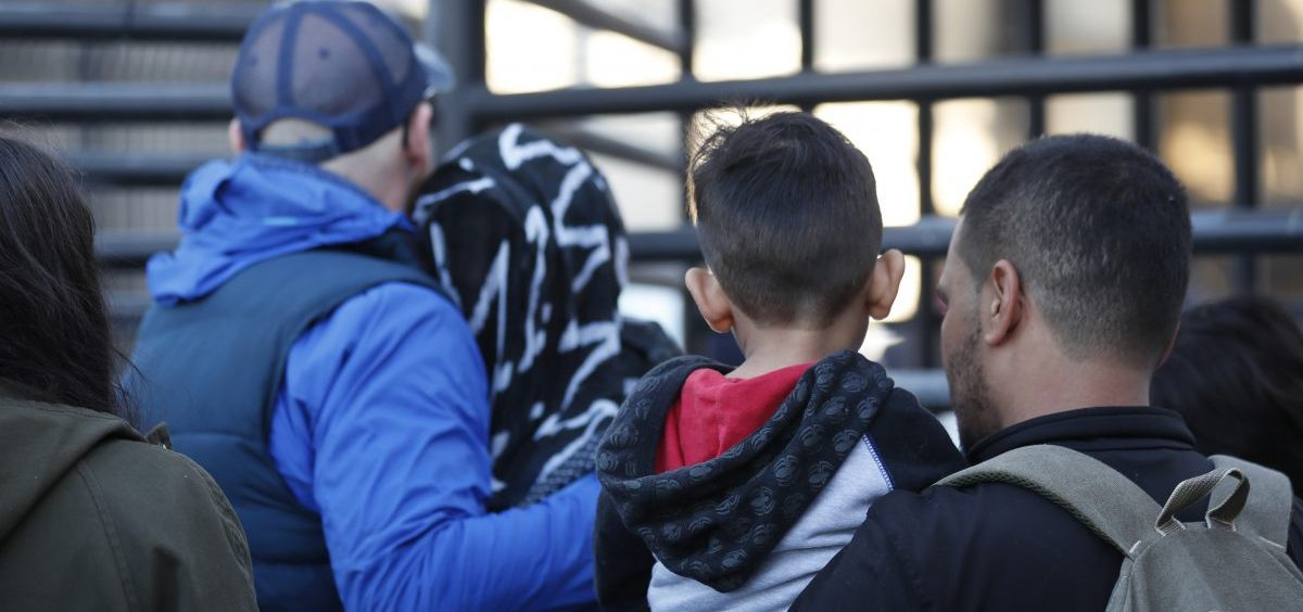 Honduran asylum seekers enter the U.S. at San Diego's Otay Mesa port of entry, as seen from Tijuana, Mexico.