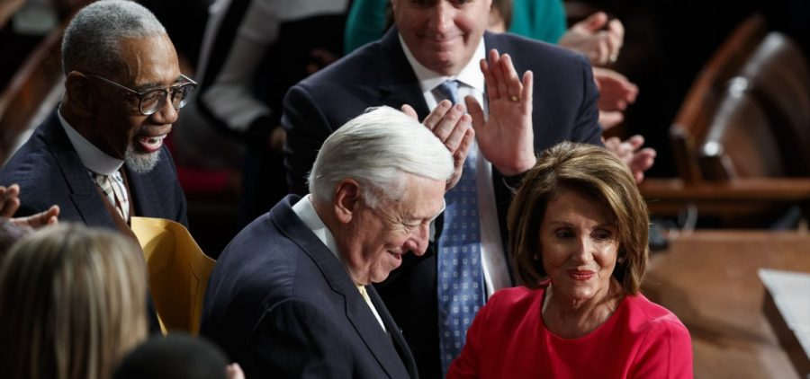New Speaker of the House Nancy Pelosi, D-Calif., and Steny Hoyer, D-Md., are applauded at the Capitol on Thursday as Democrats officially regain control of the chamber.