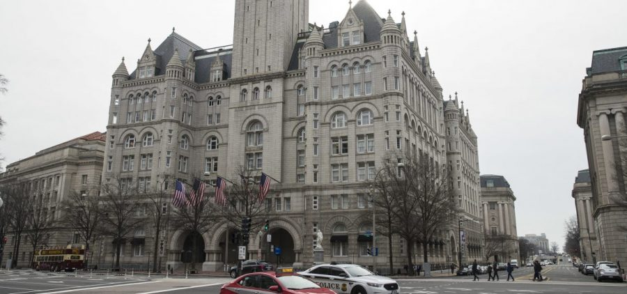 The Old Post Office Pavilion Clock Tower, which remains open during the partial government shutdown, is seen above the Trump International Hotel in Washington.