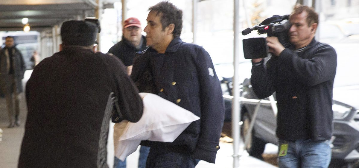 Michael Cohen dodges photojournalists as he returns home in New York City. The former fixer for Donald Trump says he's postponing testimony planned for a House hearing next month.