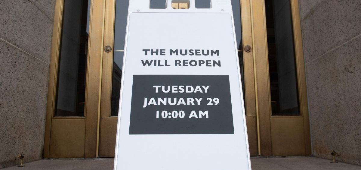 A sign at the entrance of the Smithsonian National Museum of Natural History in Washington, D.C., says the museum will reopen Tuesday. The shutdown reduced federal spending by $18 billion, although most of that will be recouped, now that the government has reopened, according to a new report.