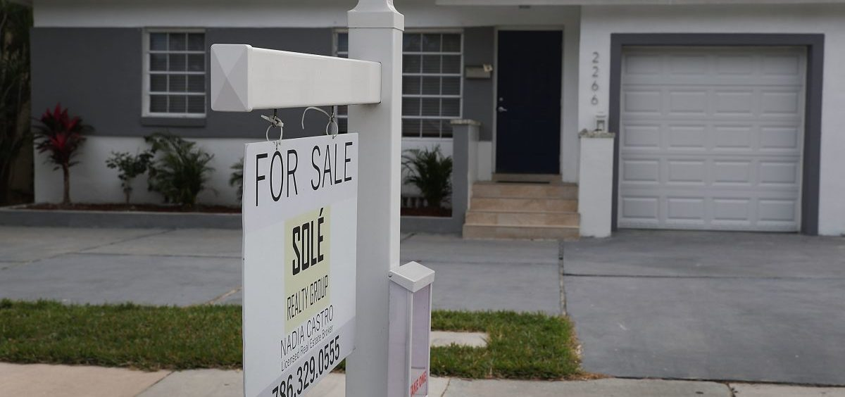 "A ""for sale"" sign is seen in front of a home in Miami on Jan. 24, 2018. The partial shutdown of the federal government is causing some financial problems for furloughed workers who can't refinance their mortgages or buy homes because lenders can't verify their income."
