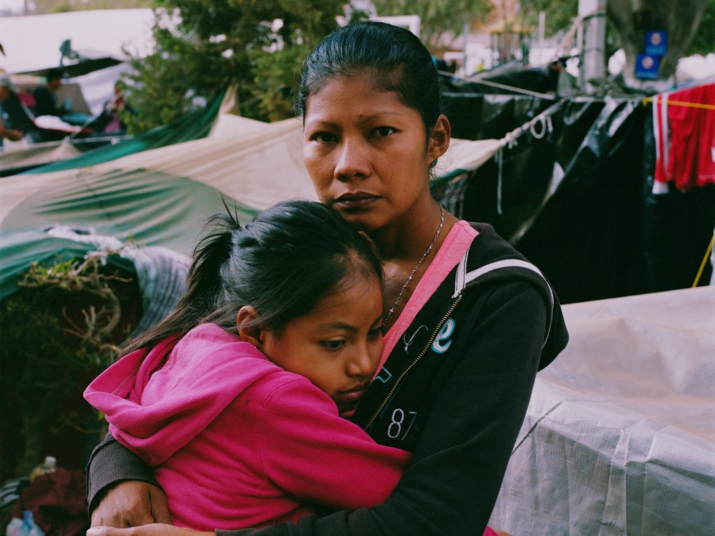 "Karen Paz hugs her daughter, Liliana Saray, 9. They are from San Pedro Sula, Honduras. ""I feel free; I feel different,"" Paz said. ""I don't have someone who imposes his views and his ways on me. I am not scared someone will come and attack me, like I used to be."""