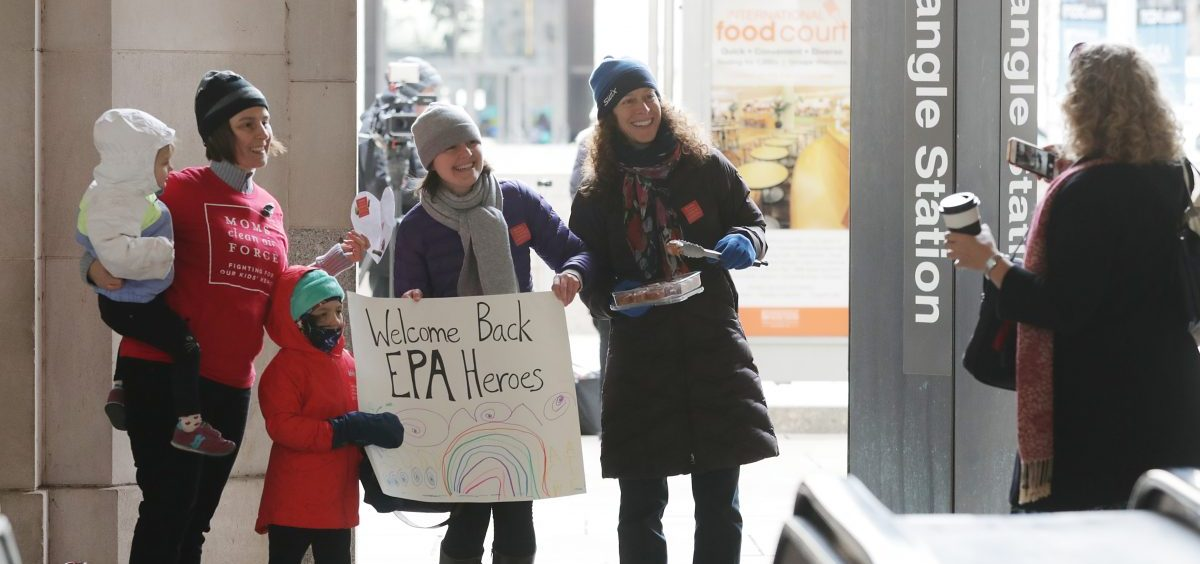 Environmental activists Liz Brandt (from left), with her daughters, Natalia, 3, and Valencia Bednar, 5; Martha Roberts, and Molly Rauch pose for a photograph while welcoming Environmental Protection Agency employees back to work on Jan. 28 in Washington, D.C. Furloughed employees returned to work following the end of the longest-ever partial federal government shutdown.