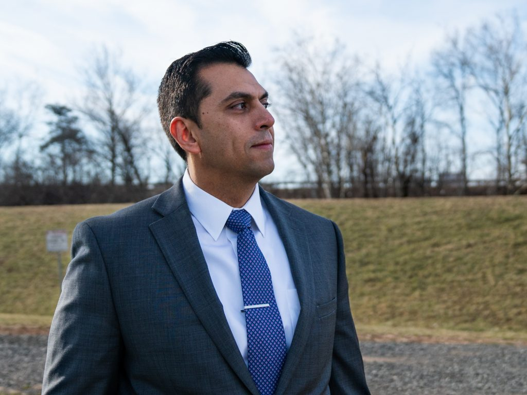 """Town Councilman Abel Gomez stands near a levee in Bound Brook. """"Without flood control,"""" he said, """"you were always the next natural disaster before you were wiped out."""""""