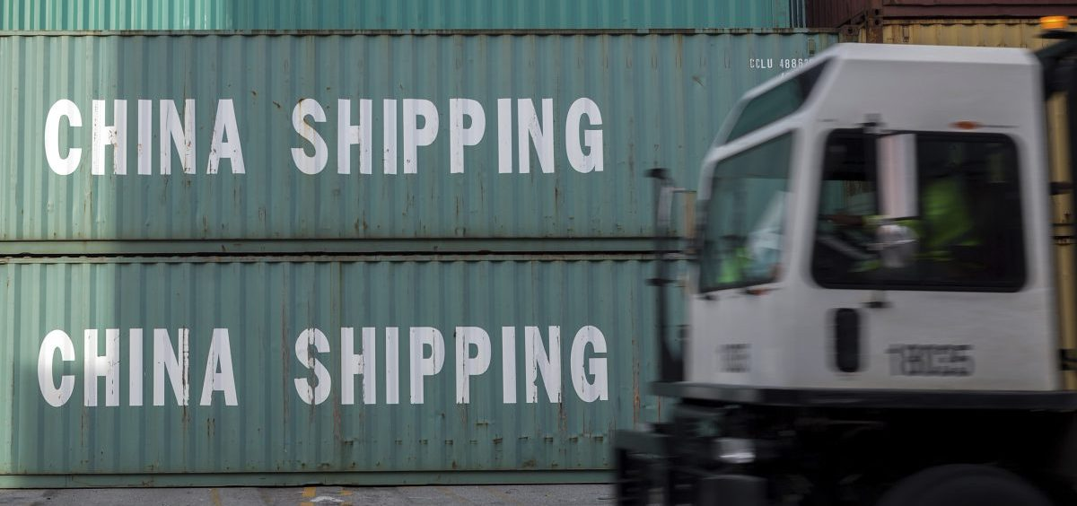 A truck passes a stack of China Shipping containers at the Port of Savannah in Georgia on July 5, 2018. The U.S. goods trade deficit with China hit a record $419.2 billion in 2018.