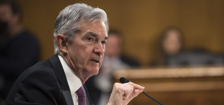 "Federal Reserve Chairman Jerome Powell testifies before the Senate Banking Committee on Feb. 26. ""It may be some time before the outlook for jobs and inflation calls clearly for a change in policy,"" he said Wednesday."