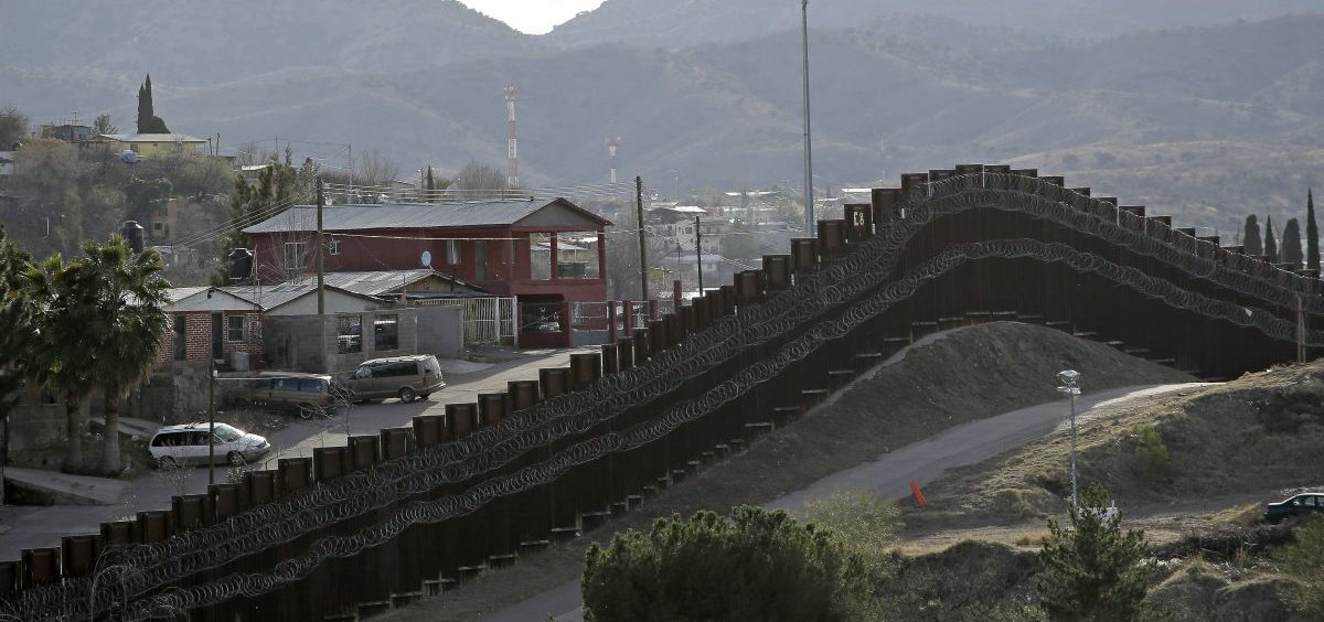 The president declared a national emergency in February to access federal money to build a wall similar to this razor-wire-covered border wall separating Nogalas, Mexico (left) and Nogales, Ariz. Congress did not approve the full amount he asked for last year to follow through on a key campaign pledge.