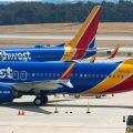 """A Boeing 737 Max 8 flown by Southwest Airlines sits at the gate at Baltimore Washington International Airport on Wednesday. """"The grounding will remain in effect pending further investigation, including examination of information from the aircraft's flight data recorders and cockpit voice recorders,"""" the FAA said in a statement."""