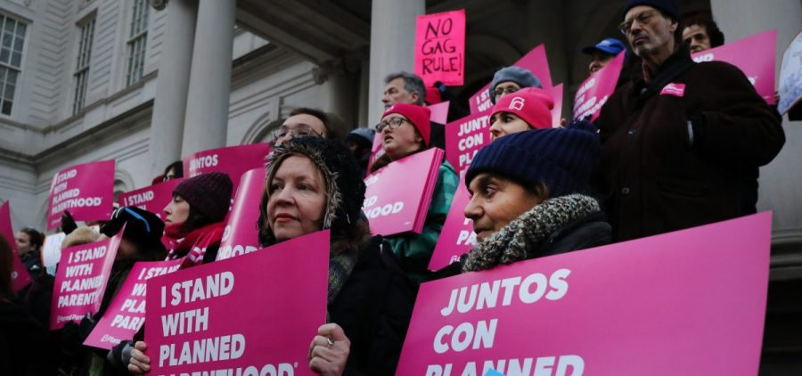 Abortion-rights activists, politicians and others associated with Planned Parenthood gather for a demonstration against the Trump administration's Title X rule change on Feb. 25 in New York. Multiple lawsuits have been filed opposing the new rule.