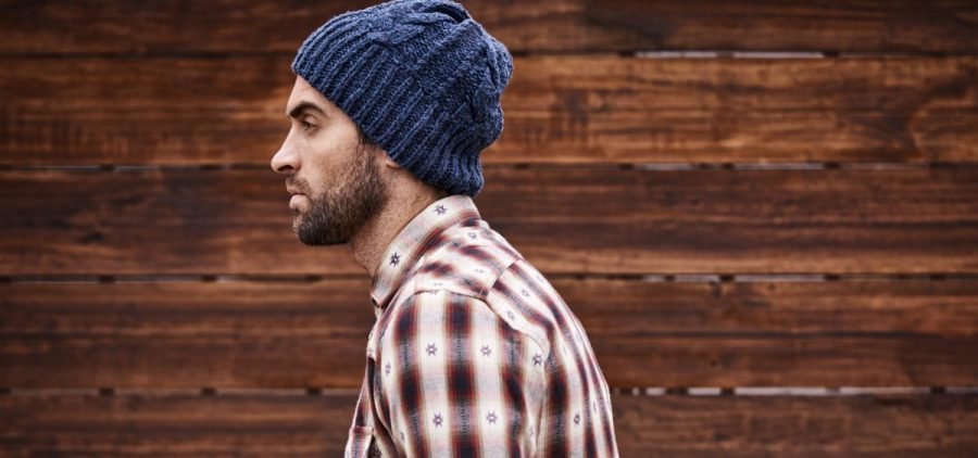 "This is the unedited version of a contested photo from an MIT Technology Review article on hipsters. Original caption: ""Shot of a handsome young man in trendy winter attire against a wooden background."""