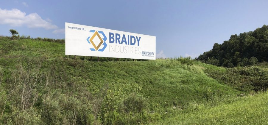 This Aug. 22, 2018, file photo shows a sign declaring the future home of Braidy Industries' aluminum mill in Ashland, Ky.