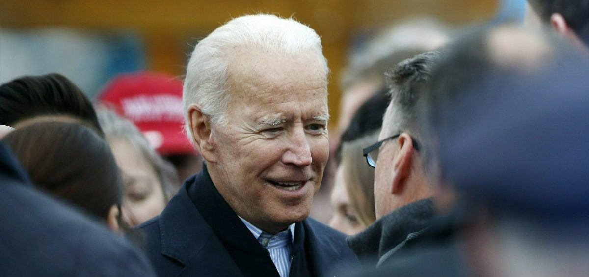 In this April 18, 2019, file photo, former vice president Joe Biden talks with officials after speaking at a rally in support of striking Stop & Shop workers in Boston