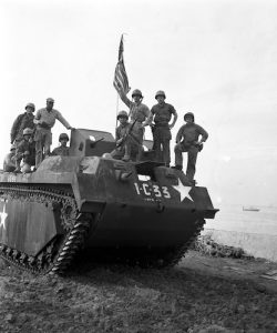 group of soldiers standing on tank