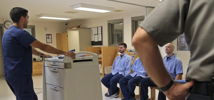 In Massachusetts last July, several Franklin County Jail inmates, seated, were watched by a nurse (left) and a corrections officer after receiving their daily doses of buprenorphine, a drug that helps control opioid cravings. By some estimates, at least half to two thirds of today's U.S. jail population has a substance use or dependence problem.