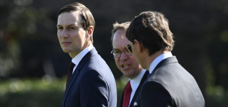 White House adviser Jared Kushner, left, is among those whose security clearance Democrats question.