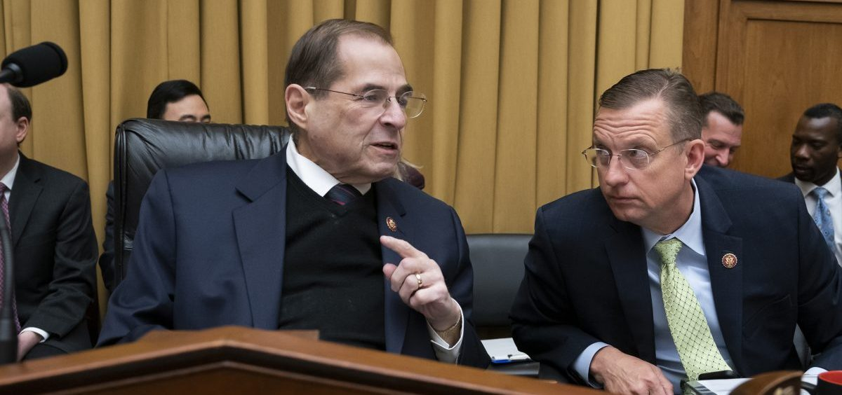 House Judiciary Committee Chair Jerrold Nadler, D-N.Y., debated with ranking member Doug Collins, R-Ga., (right) about his move to subpoena the Justice Department to obtain an unredacted copy of the Mueller report at a committee markup Wednesday.