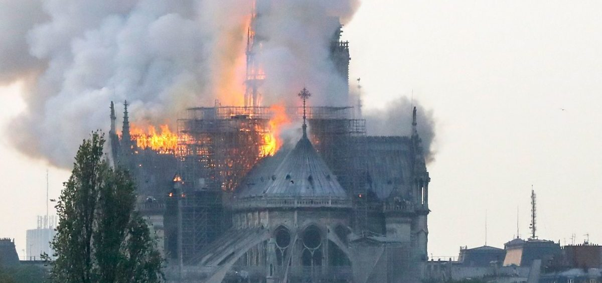 Smoke ascends as flames rise during a fire at the landmark Notre Dame Cathedral in central Paris on Monday.