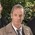 Grantchester photo. Two priests behind a detective